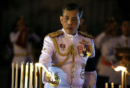 Thailand's Crown Prince Maha Vajiralongkorn attends an event commemorating the death of King Chulalongkorn, known as King Rama V, as he joins people during the mourning of his father, the late King Bhumibol Adulyadej, at the Royal Plaza in Bangkok