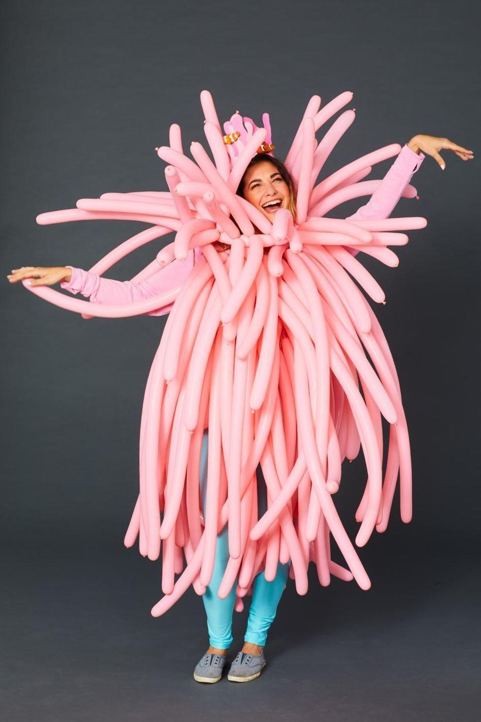 """<p>To really make an entrance at your next Halloween party, blow up long, pink balloons and attach them by the knot to a pink shirt with safety pins. </p><p><a class=""""link rapid-noclick-resp"""" href=""""https://www.amazon.com/Pioneer-Balloon-Company-Latex-Balloons/dp/B004R4F35M?tag=syn-yahoo-20&ascsubtag=%5Bartid%7C10070.g.490%5Bsrc%7Cyahoo-us"""" rel=""""nofollow noopener"""" target=""""_blank"""" data-ylk=""""slk:SHOP PINK BALLOONS"""">SHOP PINK BALLOONS</a></p>"""
