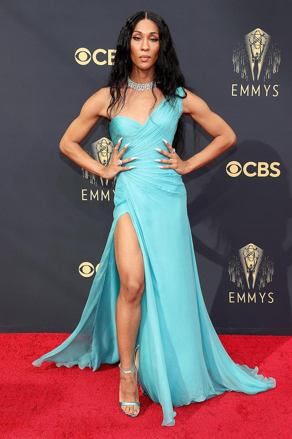 <p>in a sparkly teal Atelier Versace one-shoulder gown with ruched bodice, plus Bulgari jewelry. </p>