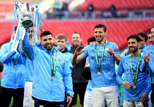 Manchester City's Sergio Aguero lifts the Carabao Cup trophy