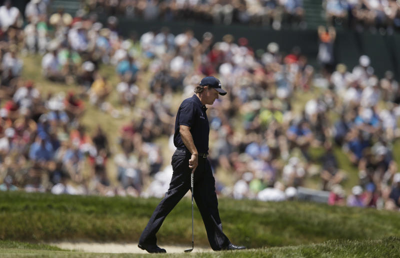Phil Mickelson walks to the seventh hole during the third round of the U.S. Open Championship golf tournament Saturday, June 16, 2012, at The Olympic Club in San Francisco. (AP Photo/Charlie Riedel)