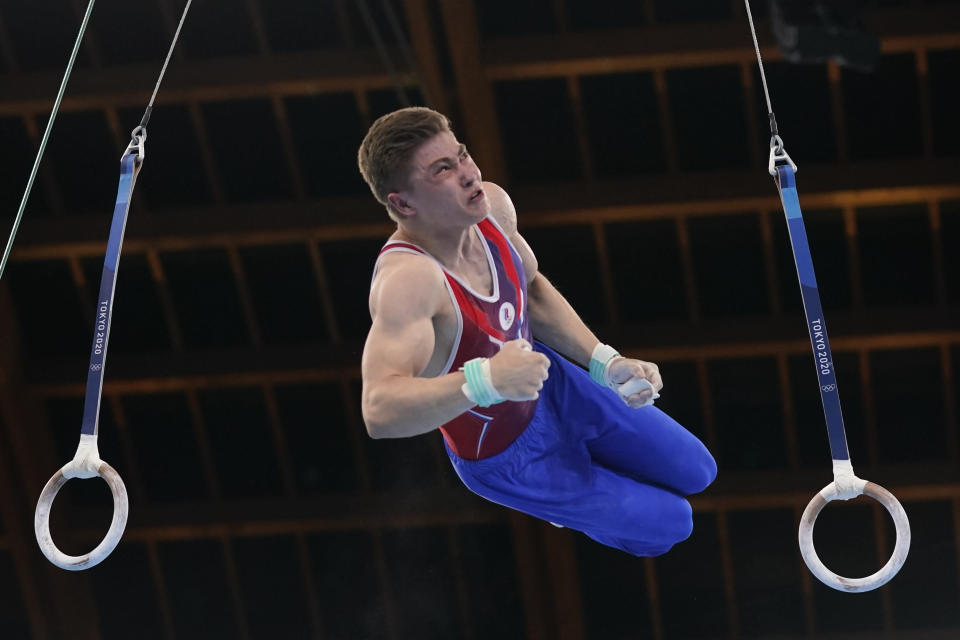 The Russian Olympic Committee's Aleksandr Kartsev performs on the rings during the men's artistic gymnastic qualifications at the 2020 Summer Olympics, Saturday, July 24, 2021, in Tokyo. (AP Photo/Gregory Bull)