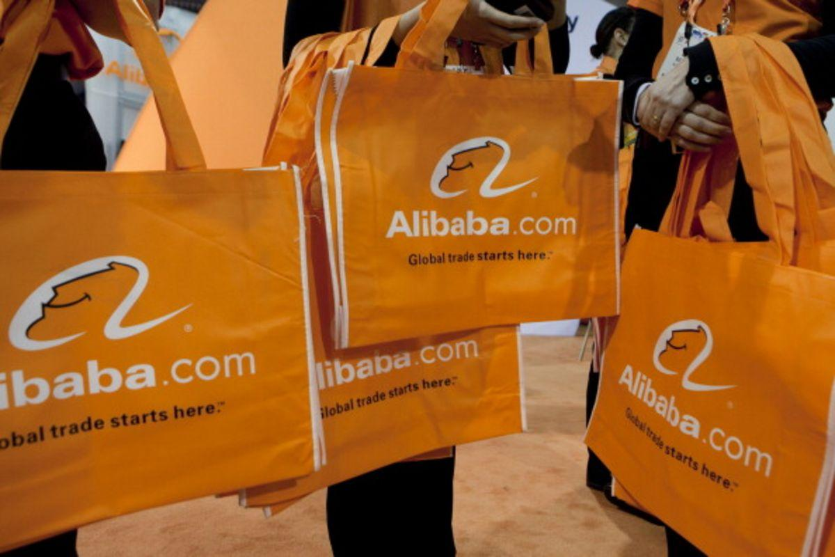 Alibaba.com Ltd. bags are distributed at the 2012 International Consumer Electronics Show (CES) in Las Vegas, Nevada, U.S., on Friday, Jan. 13, 2012. Alibaba Group Holding Ltd. is considering reducing the size of a loan for a potential Yahoo! Inc. acquisition to around $3 billion from the original target of $4 billion in order to use its cash instead. Photographer: Andrew Harrer/Bloomberg via Getty Images