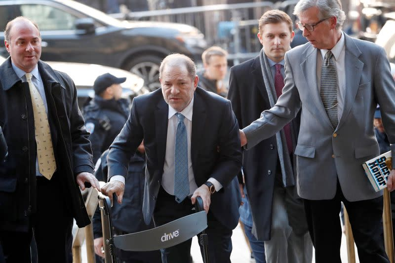 FILE PHOTO: Harvey Weinstein arrives at New York Criminal Court for another day of jury deliberations in his sexual assault trial in the Manhattan borough of New York City