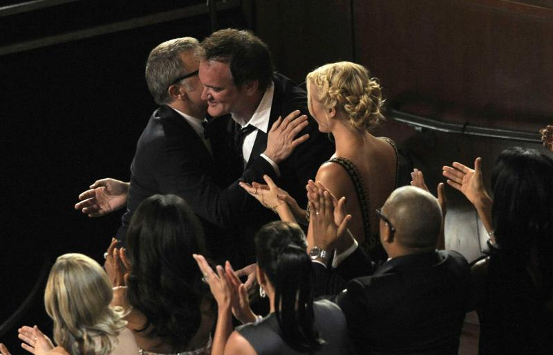 """Director Quentin Tarantino, right, hugs Christoph Waltz, left, after Waltz is announced as the winner of the award for best actor in a supporting role for """"Django Unchained"""" during the Oscars at the Dolby Theatre on Sunday Feb. 24, 2013, in Los Angeles. (Photo by Chris Pizzello/Invision/AP)"""