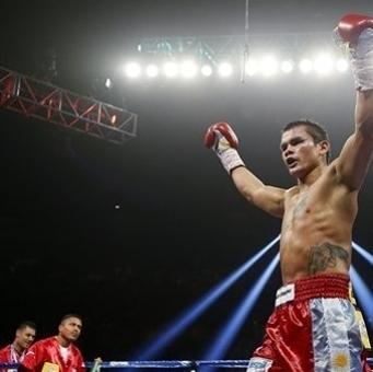 Marcos Maidana, of Argentina, celebrates his victory over Jesus Soto Karass, of Mexico, following their welterweight boxing match, Saturday, Sept. 15, 2012, in Las Vegas. (AP Photo/Isaac Brekken)