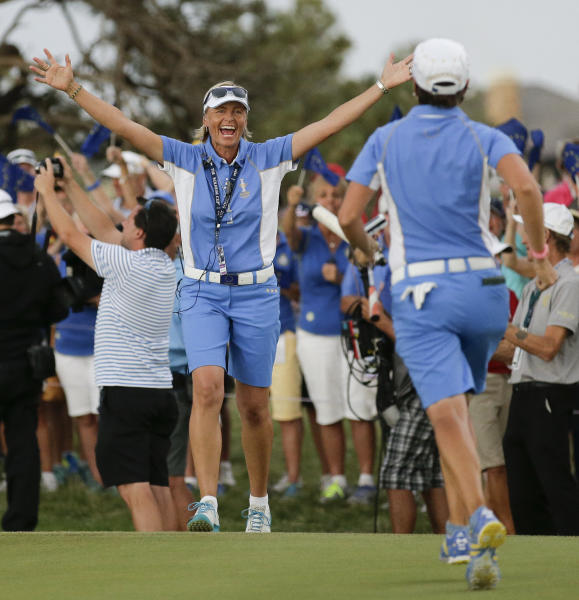 Europe's captain Liselotte Neumann, left, of Sweden, greets Europe's Catriona Matthew, of Scotland, after they win Solheim Cup golf tournament against the United States, Sunday, Aug. 18, 2013, in Parker, Colo. (AP Photo/Chris Carlson)