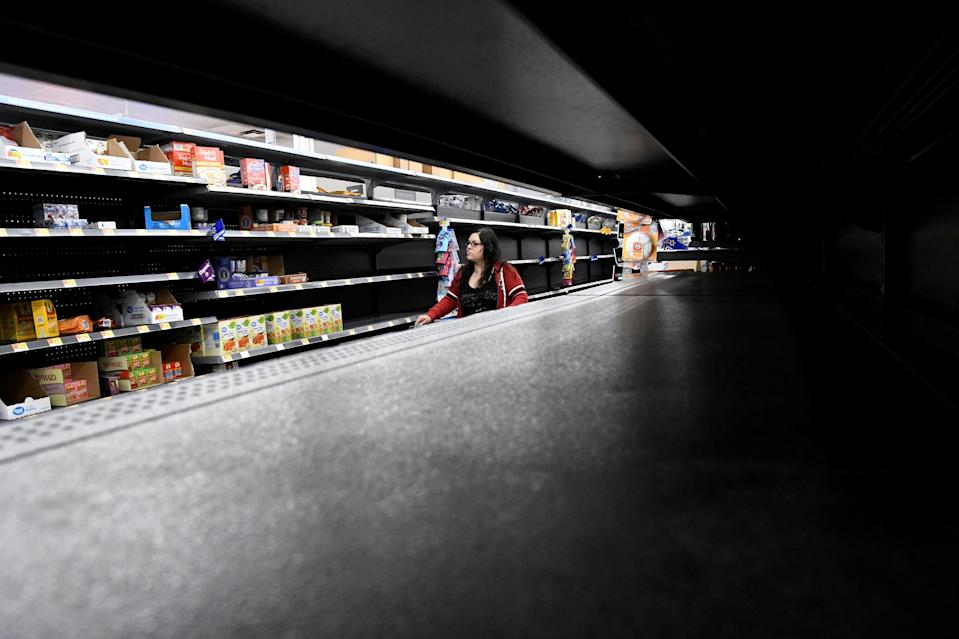 <p>Nina Roberts shops for last minute supplies while shelves remain empty as Hurricane Lane approaches Honolulu, Hawaii, Aug. 23, 2018. (Photo: Hugh Gentry/Reuters) </p>