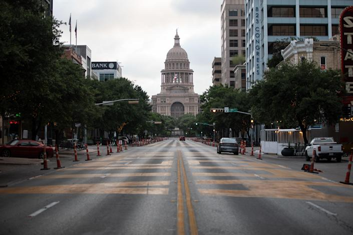 Cars drive on Congress Avenue in front of the Texas Capitol building on July, 14, 2020 in Austin, Texas.  (Getty Images)