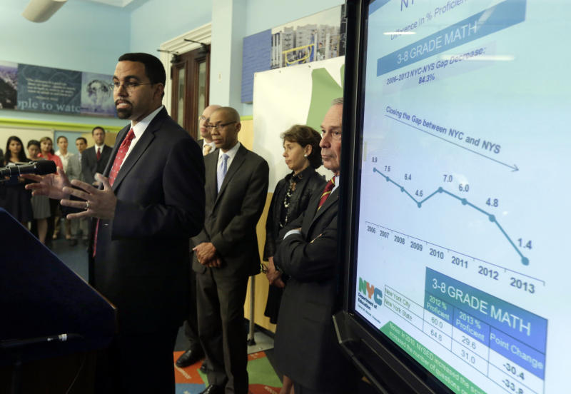 New York state Commissioner of Education John King Jr., left, talks about standardized test scores during a news conference, in New York, Wednesday, Aug. 7, 2013. Less than a third of New York students in grades three through eight scored well enough on statewide tests to be considered proficient in math and English last spring. New York is only the second state, after Kentucky, to test students based on the more rigorous Common Core learning standards adopted by most states as a way to improve student readiness for college and careers. He is joined by New York City Schools Chief Accountability Officer Shael Polakow-Suransky, New York City Schools Chancellor Dennis Walcott, state Regents Chancellor Merryl Tisch, and New York Mayor Michael Bloomberg, background left to right. (AP Photo/Richard Drew)