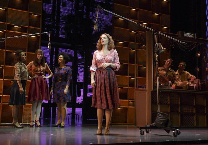 "This image released by The O and M Company shows Jessie Mueller as Carole King, center, in ""Beautiful: Carol King the Musical,"" in New York. Mueller is part of a new wave of musicals featuring female singer-songwriters, a list that includes a Billie Holiday show now off-Broadway and two planned musicals on Diane Warren and Patsy Cline. (AP Photo/The O and M Company, Joan Marcus)"