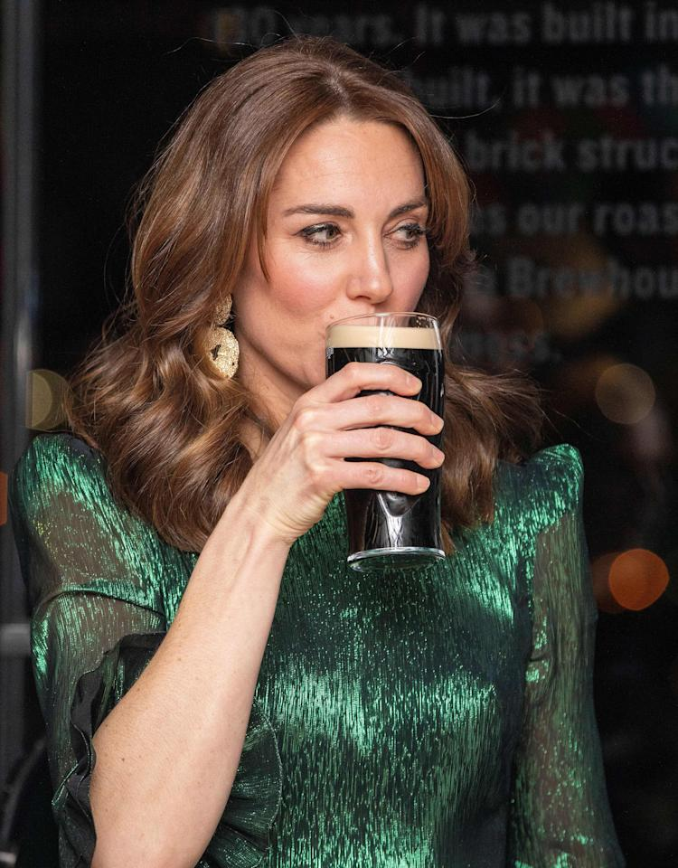 Britain's  Catherine, Duchess of Cambridge, drinks a  pint of Guinness during as she attends a special reception at the Guinness Storehouses Gravity Bar in Dublin on March 3, 2020 on the first day of their Royal Highnesses three-day visit. (Photo by PAUL FAITH / various sources / AFP) (Photo by PAUL FAITH/AFP via Getty Images)