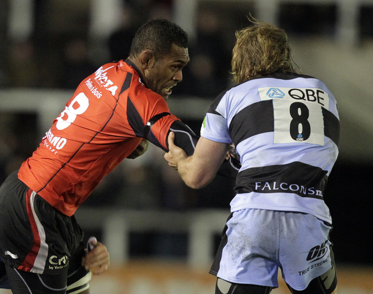 Newcastle Falcons' Richard Mayhew (R) tackles Toulon's Seva Rokobaro (L) during a pool 2, European Challenge Cup rugby union match at Kingston Park, Newcastle upon Tyne, England, on December 08, 2011. AFP PHOTO/GRAHAM STUART (Photo credit should read GRAHAM STUART/AFP/Getty Images)