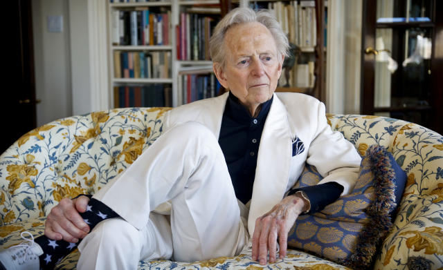 "American author and journalist Tom Wolfe, Jr. appears in his living room during an interview about his latest book, ""The Kingdom of Speech,"" in New York. Wolfe died at a New York City hospital. He was 88. (AP Photo/Bebeto Matthews, File)"