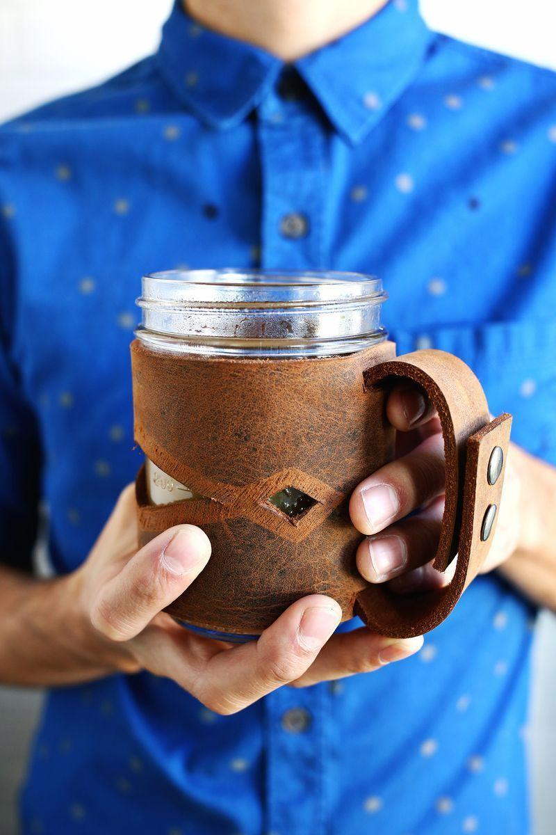 """<p>Surprisingly simple and inexpensive to make, this handsome leather sleeve is a perfect gift for the Mason jar lover who has (almost) everything.</p><p><strong>Get the tutorial at <a href=""""https://abeautifulmess.com/leather-mason-jar-sleeve/"""" rel=""""nofollow noopener"""" target=""""_blank"""" data-ylk=""""slk:A Beautiful Mess"""" class=""""link rapid-noclick-resp"""">A Beautiful Mess</a>.</strong></p><p><a class=""""link rapid-noclick-resp"""" href=""""https://www.amazon.com/General-Tools-72-Leather-Punch/dp/B00004T7WS/ref=asc_df_B00004T7WS/?tag=syn-yahoo-20&ascsubtag=%5Bartid%7C10050.g.2132%5Bsrc%7Cyahoo-us"""" rel=""""nofollow noopener"""" target=""""_blank"""" data-ylk=""""slk:SHOP LEATHER PUNCHES"""">SHOP LEATHER PUNCHES</a><br></p>"""