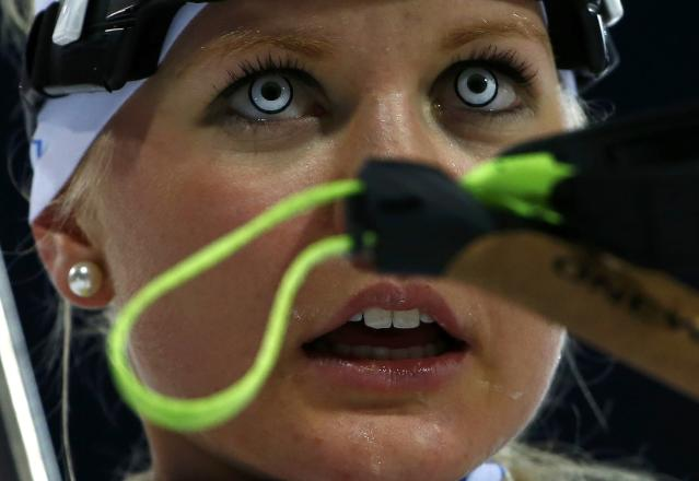 Estonia's Grete Gaim reacts after crossing the finish line during the women's biathlon 7.5km sprint event at the Sochi 2014 Winter Olympics in Rosa Khutor February 9, 2014. REUTERS/Carlos Barria (RUSSIA - Tags: SPORT BIATHLON OLYMPICS TPX IMAGES OF THE DAY)