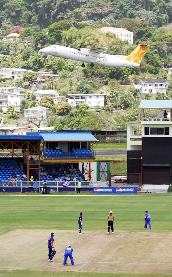 Kingstown, SAINT VINCENT AND THE GRENADINES: An aircraft takes off from E.T. Joshua Airport adjacent to Arnos Vale stadium where England (batting) are playing Bermuda in a warm-up game in Kingstown, St. Vincent 05 March 2007. The 2007 Cricket World Cup begins 13 March staged across The West Indies. AFP PHOTO ADRIAN DENNIS (Photo credit should read ADRIAN DENNIS/AFP/Getty Images)