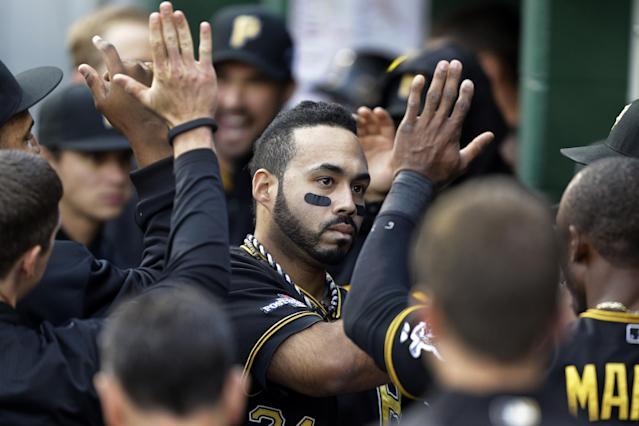 Pittsburgh Pirates' Pedro Alvarez celebrates with teammates in the dugout after getting the Pirates' only hit of the day, a solo home run off St. Louis Cardinals pitcher Michael Wacha in the eighth inning of Game 4 of a National League baseball division series, Monday, Oct. 7, 2013, in Pittsburgh. The Cardinals won 2-1 to even the best-of-five series. (AP Photo/Gene J. Puskar)