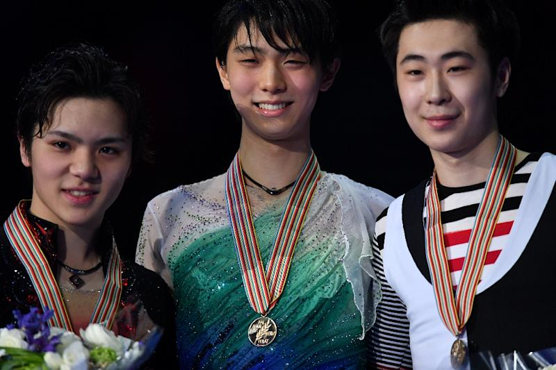 (L-R) Shoma Uno, Yuzuru Hanyu and Boyan Jin pose with their medals after the World Figure Skating Championships in Helsinki, on April 1, 2017 (AFP Photo/Daniel MIHAILESCU)