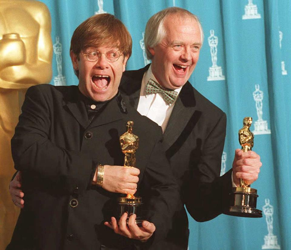 """LOS ANGELES, CA - MARCH 28:  British singer and songwriter Elton John (L) poses with partner Tim Rice 27 March at the 67th annual Academy Awards in Los Angeles. John and Rice won Oscars for their original song """"Can You Feel the Love Tonight?"""" from the film """"The Lion King.""""       AFP PHOTO  (Photo credit should read DAN GROSHONG/AFP/Getty Images)"""