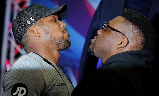"Jarrell Miller (right) could miss his chance at beating Anthony Joshua (left) due to an ""adverse"" doping test (AFP Photo/Adrian DENNIS)"