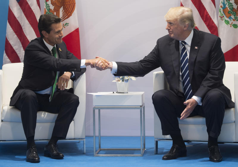 US President Donald Trump and Mexican President Enrique Pena Nieto shake hands during a meeting on the sidelines of the G20 Summit in Hamburg, Germany, in July, 2017, but tentative plans for a meeting in Washington have reportedly been shelved (AFP/Archivos | SAUL LOEB)