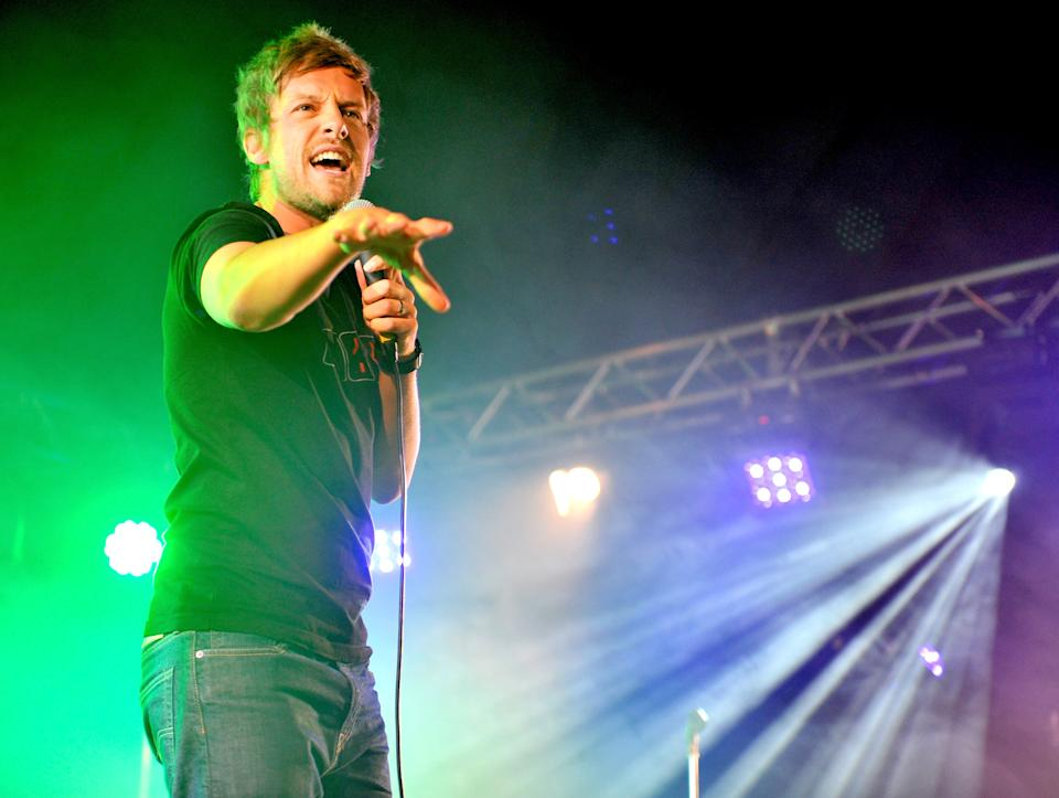 LEEDS, ENGLAND - AUGUST 23:  Comedian Chris Ramsey performs on Day 2 of the Leeds Festival at Bramham Park on August 23, 2014 in Leeds, England.  (Photo by Shirlaine Forrest/WireImage)