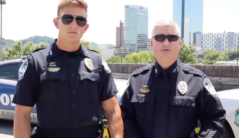 Social media users couldn't stop commenting on Officer Derrick White (left) while he attempted to inform drivers of the new Hands Free Law, which went into effect on Monday in Tennessee. (Photo: Twitter)