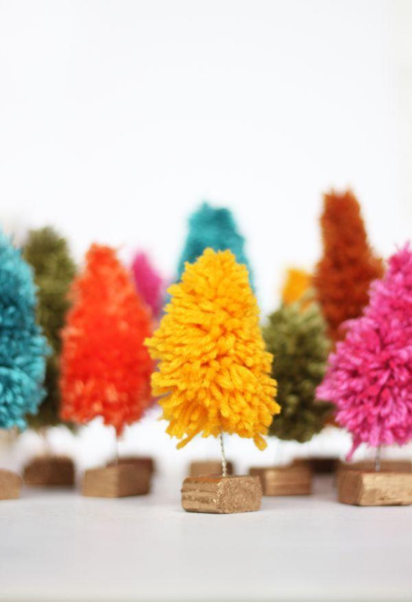 """<p>A little pop of color might be all you need to keep Grandpa awake at the dinner table this year! </p><p><em><a href=""""http://thesweetescape.ca/2014/12/diy-yarn-mini-christmas-trees.html#sthash.Nj1CjZBN.dVNaxiRw.dpbs"""" rel=""""nofollow noopener"""" target=""""_blank"""" data-ylk=""""slk:Get the tutorial from the Sweet Escape »"""" class=""""link rapid-noclick-resp"""">Get the tutorial from the Sweet Escape »</a></em><strong><br></strong></p>"""