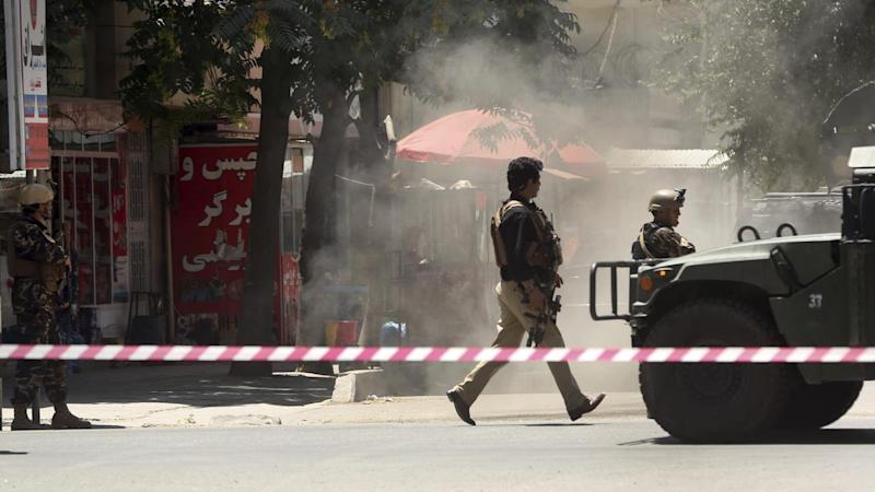 Security forces respond to an Islamic State attack on Iraq's embassy in Kabul.