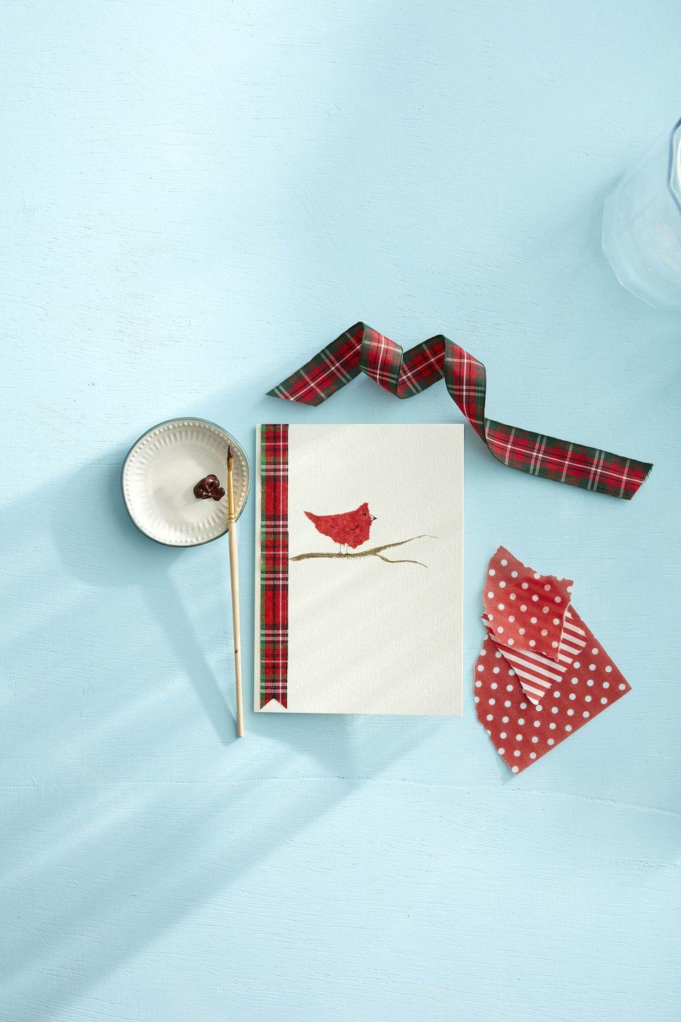 """<p>This sweet fella will chirp out a holiday greeting to all of your loved ones this season. </p><p><strong>To make:</strong> Paint a branch on a plain card with brown craft paint. Tear a bird shape from red tissue paper and glue to the card just above the branch, leaving enough room for legs. Once dry, use a fine point black marker to draw on legs, a wing, an eye, and a beak. Glue a piece of ribbon along the fold edge of the card for extra flair.</p><p><a class=""""link rapid-noclick-resp"""" href=""""https://www.amazon.com/Micro-Pen-Fineliner-Anti-Bleed-Waterproof-Calligraphy/dp/B0722Y98KS/ref=sr_1_3_sspa?tag=syn-yahoo-20&ascsubtag=%5Bartid%7C10050.g.3872%5Bsrc%7Cyahoo-us"""" rel=""""nofollow noopener"""" target=""""_blank"""" data-ylk=""""slk:SHOP BLACK MARKER"""">SHOP BLACK MARKER</a></p>"""
