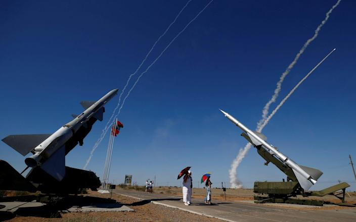 People watch S-300 air defense missile systems launching missiles - REUTERS
