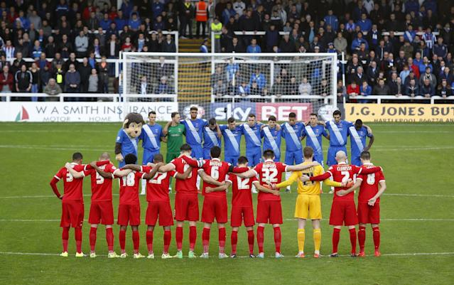 "Football - Hartlepool United v Leyton Orient - Sky Bet Football League Two - Victoria Park - 15/11/15 General view as players and fans pause during a minutes silence in memory of the Paris attacks before the match Action Images via Reuters / Ed Sykes Livepic EDITORIAL USE ONLY. No use with unauthorized audio, video, data, fixture lists, club/league logos or ""live"" services. Online in-match use limited to 45 images, no video emulation. No use in betting, games or single club/league/player publications. Please contact your account representative for further details."