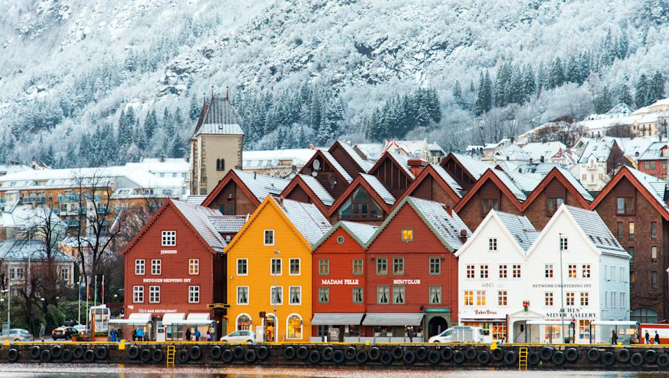 """Bergen has all the makings of an idyllic Nordic village: <a href=""""https://www.cntraveler.com/gallery/most-colorful-places-in-the-world?mbid=synd_yahoo_rss"""" rel=""""nofollow noopener"""" target=""""_blank"""" data-ylk=""""slk:colorful wooden buildings"""" class=""""link rapid-noclick-resp"""">colorful wooden buildings</a>, a scenic harbor, and sweeping views of the surrounding fjords. The town looks beautiful in the summer, sure, but it's during the winter months that you get to view the <a href=""""https://www.cntraveler.com/stories/2011-11-07/best-places-to-stay-to-see-the-northern-lights?mbid=synd_yahoo_rss"""" rel=""""nofollow noopener"""" target=""""_blank"""" data-ylk=""""slk:Northern Lights"""" class=""""link rapid-noclick-resp"""">Northern Lights</a> during their peak season. If you're going to be freezing up in Scandinavia, you might as well get to cross an astronomical wonder off of your bucket list."""