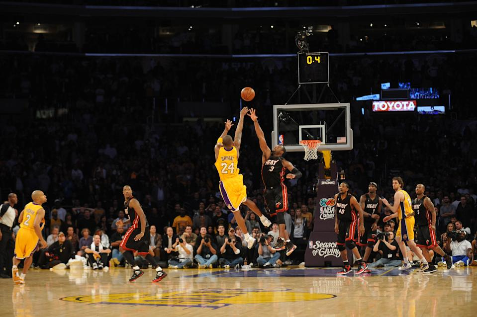 Kobe Bryant developed a reputation as a clutch performer, making 27 game-winning shots in his 20-year career. Here is one over the Miami Heat's Dwyane Wade in December 2009. (Noah Graham/NBAE via Getty Images)