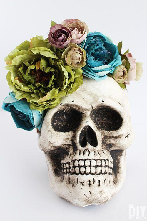 """<p>Pretty meets scary in this DIY decoration that's sure to haunt any guy or ghoul who comes near.</p><p><strong>Get the tutorial at <a href=""""https://thediydreamer.com/diy/halloween-centerpiece-skull-floral-arrangement/"""" rel=""""nofollow noopener"""" target=""""_blank"""" data-ylk=""""slk:The DIY Dreamer"""" class=""""link rapid-noclick-resp"""">The DIY Dreamer</a>. </strong></p><p><strong><a class=""""link rapid-noclick-resp"""" href=""""https://www.amazon.com/Readaeer-Replica-Realistic-Human-Skull/dp/B017XSJ6BK/ref=sr_1_7?tag=syn-yahoo-20&ascsubtag=%5Bartid%7C10050.g.3739%5Bsrc%7Cyahoo-us"""" rel=""""nofollow noopener"""" target=""""_blank"""" data-ylk=""""slk:SHOP HALLOWEEN SKULLS"""">SHOP HALLOWEEN SKULLS </a></strong></p>"""