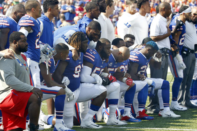 <p>Buffalo Bills players take a knee during the playing of the national anthem prior to an NFL football game against the Denver Broncos, Sunday, Sept. 24, 2017, in Orchard Park, N.Y. (AP Photo/Jeffrey T. Barnes) </p>