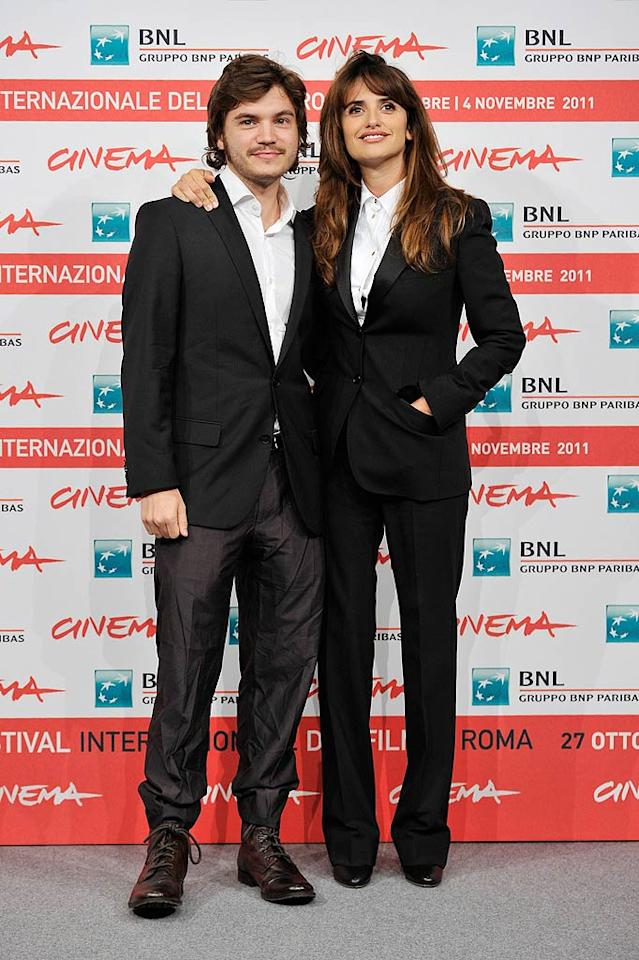 Wow! Penelope Cruz even looks good in menswear! The 37-year-old Spanish-born beauty wore a tailored black suit and tuxedo shirt on the red carpet of the International Rome Film Festival on Wednesday, where she posed with actor Emile Hirsch. Wonder if they coordinated outfits the night before ... (10/26/2011)