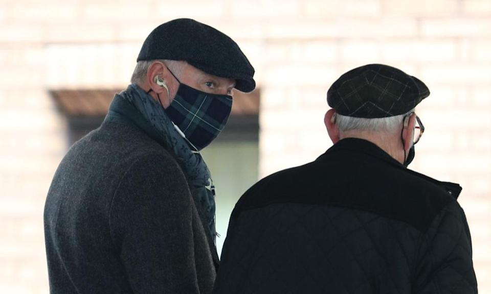 John Leslie (left) arrives with his father Lesley Stott at Southwark crown court, London.