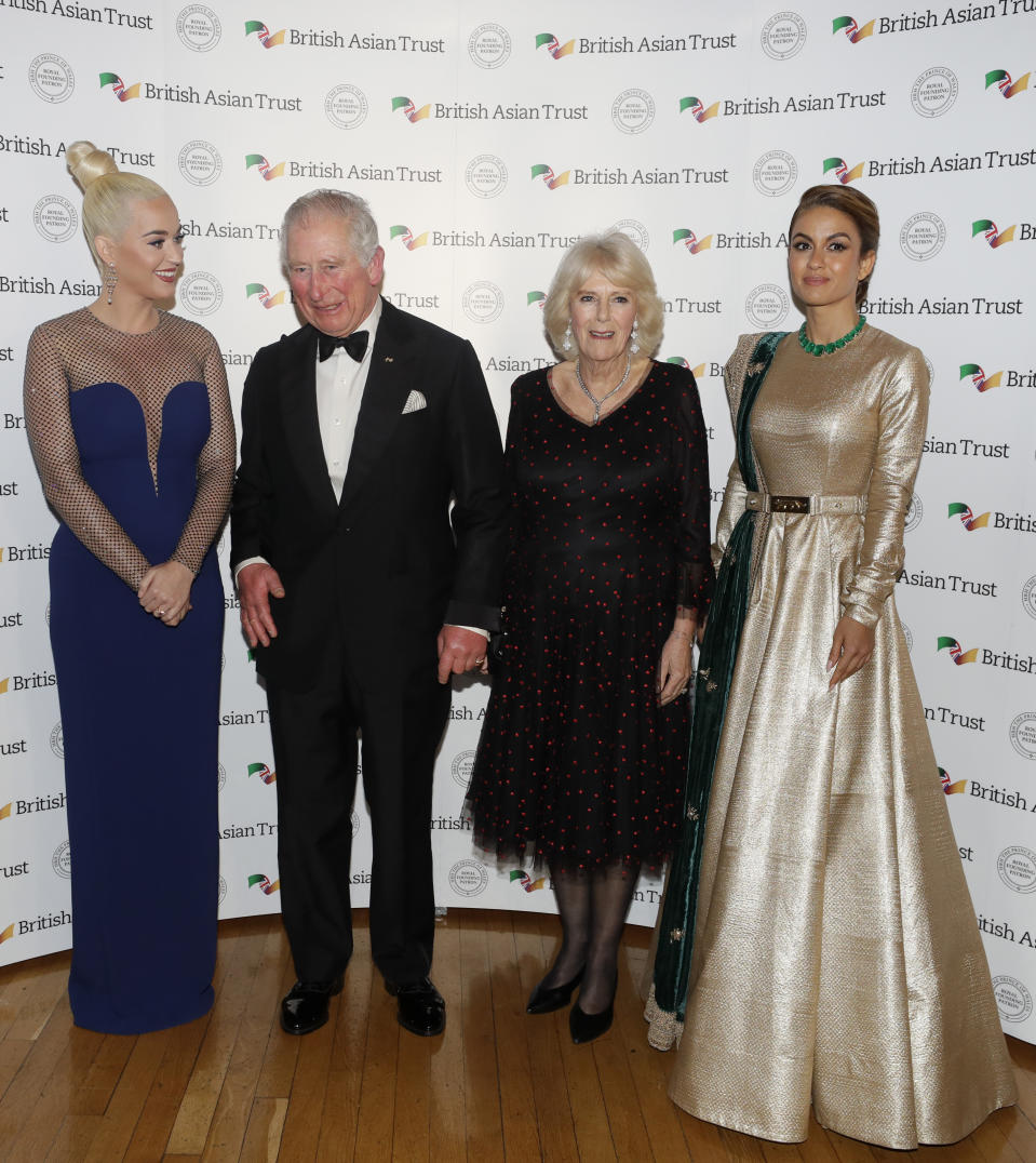 The Prince of Wales and the Duchess of Cornwall with Indian businesswoman Natasha Poonawalla (right) and musician Katy Perry (left), as they attend a reception for supporters of the British Asian Trust at Banqueting House, Whitehall, London.