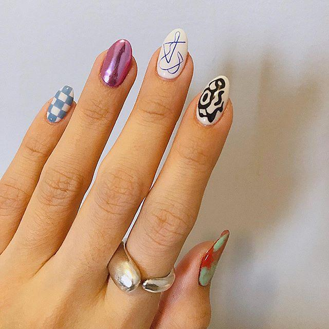 """<p>Who says you gotta go with just one gel nail design? Nobody, that's who. Show this pic to your manicurist and ask her to <strong>freestyle a different design on each of your nails. </strong>C<strong></strong>lashing is super encouraged here!</p><p><a href=""""https://www.instagram.com/p/B9Iezh0g1E_/"""">See the original post on Instagram</a></p>"""