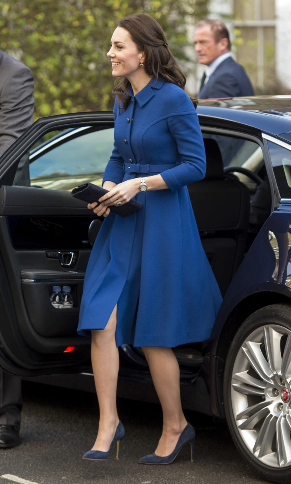 """<p>For her <a rel=""""nofollow"""" href=""""https://uk.style.yahoo.com/duchess-of-cambridge-brings-back-90s-hair-trend-on-first-work-outing-of-2017-120744931.html"""" data-ylk=""""slk:first official appearance of the year;outcm:mb_qualified_link;_E:mb_qualified_link;ct:story;"""" class=""""link rapid-noclick-resp yahoo-link"""">first official appearance of the year</a>, the Duchess donned a royal blue coat by London luxe label Eponine. Kate finished the look with her trusty Rupert Sanderson blue pumps and twisted back locks of her hair with the ultimate 90s hair accessory: the butterfly clip. </p><p><i>[Photo: Getty]</i></p>"""