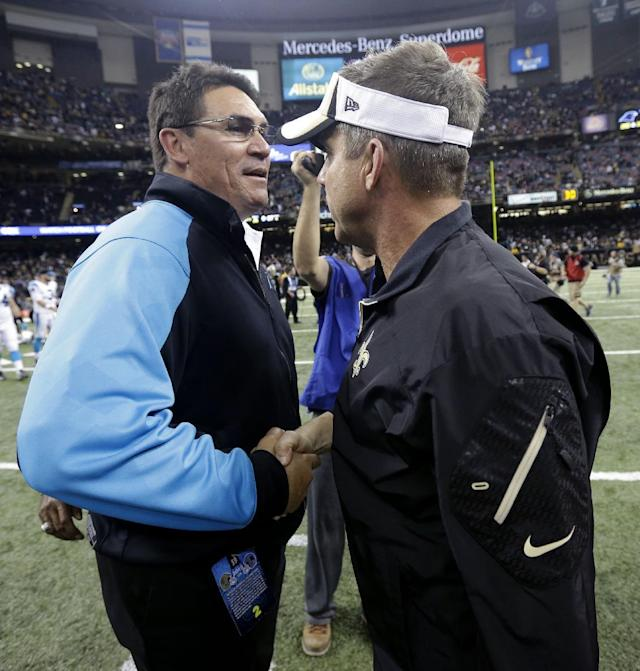 Carolina Panthers head coach Ron Rivera, left, shakes hands with New Orleans Saints head coach Sean Payton after an NFL football game in New Orleans, Sunday, Dec. 8, 2013. The Saints won 31-13. (AP Photo/Dave Martin)