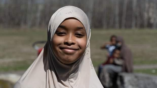 Sumaiya Hirsi, 11, worried about infecting her family after two classmates tested positive for COVID-19 at the end of March.