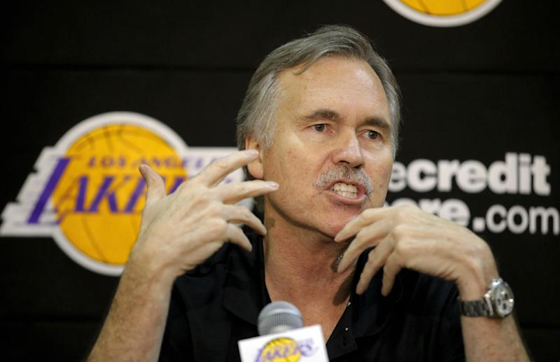 New Los Angeles Lakers coach Mike D'Antoni speaks during a news conference at the team's NBA basketball training facility in El Segundo, Calif., Thursday, Nov. 15, 2012. Although D'Antoni is still on crutches after his recent knee surgery, he is already at work with the Lakers. (AP Photo/Jae C. Hong)