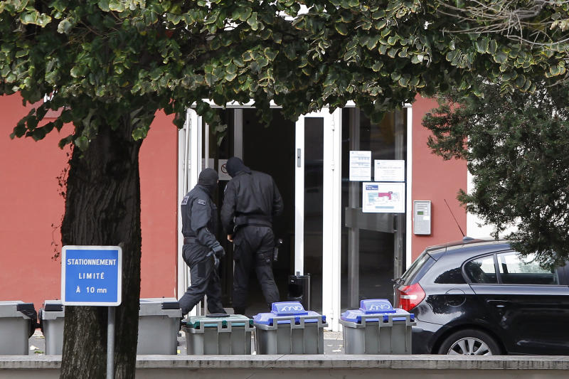 Police officers enter in a hotel where Izaskun Lesaka and another as yet unnamed suspected member of ETA has been arrested in the early hours of Sunday, in Macon, central eastern France, Sunday, Oct. 28, 2012. The suspects had been tracked by a special operations tactical unit of the French National Police and were both armed at the time of their arrest. (AP Photo/Laurent Cipriani)
