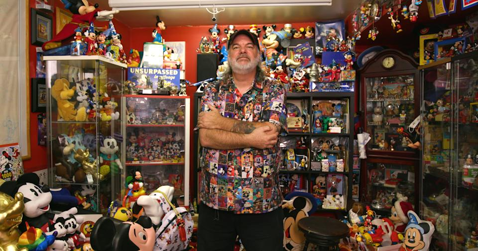 Paul Bottos with his Mickey Mouse collection. (Photo: Yahoo Lifestyle)
