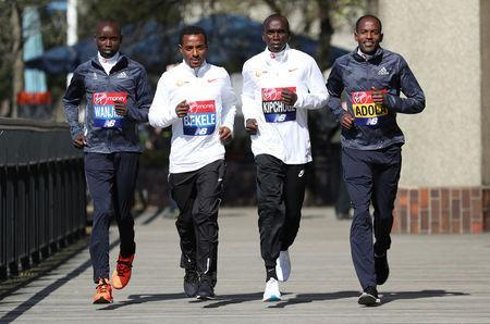 Athletics - London Marathon - Elite Men Press Conference - London, Britain - April 19, 2018 Kenya's Daniel Wanjiru and Eliud Kipchoge with Ethiopia's Kenenisa Bekele and Guye Adola pose for a photograph Action Images via Reuters/Peter Cziborra