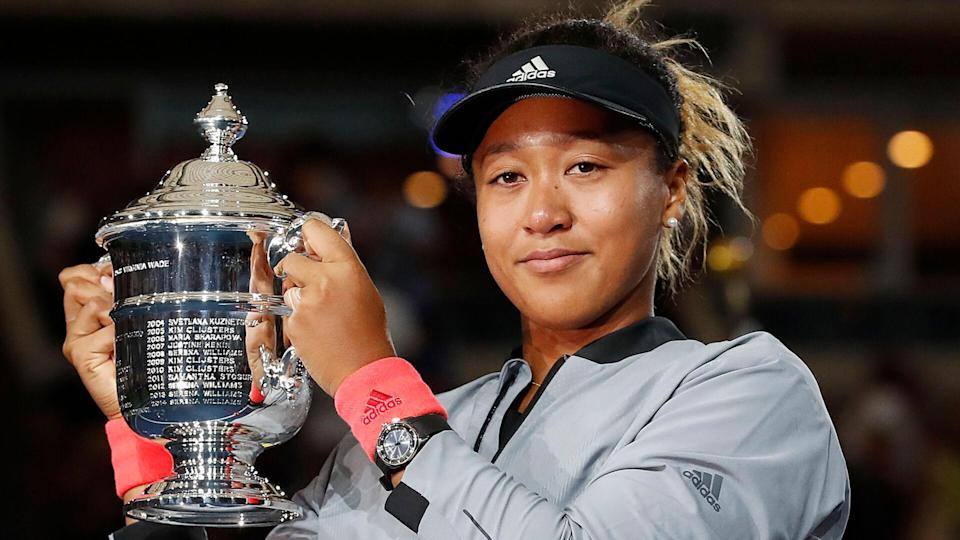 Photo by JOHN G MABANGLO/EPA-EFE/REX/Shutterstock Naomi Osaka of Japan holds up the championship trophy after defeating Serena Williams of the US in the women's final on the thirteenth day of the US Open Tennis Championships the USTA National Tennis Center in Flushing Meadows, New York, USA, 08 September 2018. The US Open runs from 27 August through 09 September.