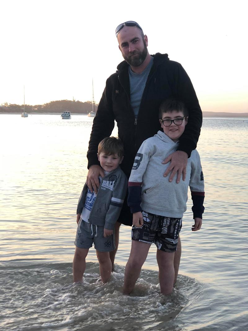 Pictured is father Nathan Brown with his two sons, Tarek and Riley, in the water.